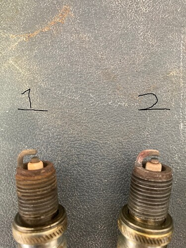 Spark plugs 1 and 2
