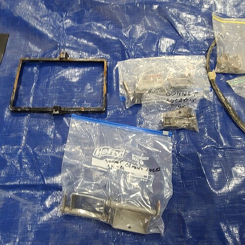 Battery Holddown and Bonnet Locking Pieces
