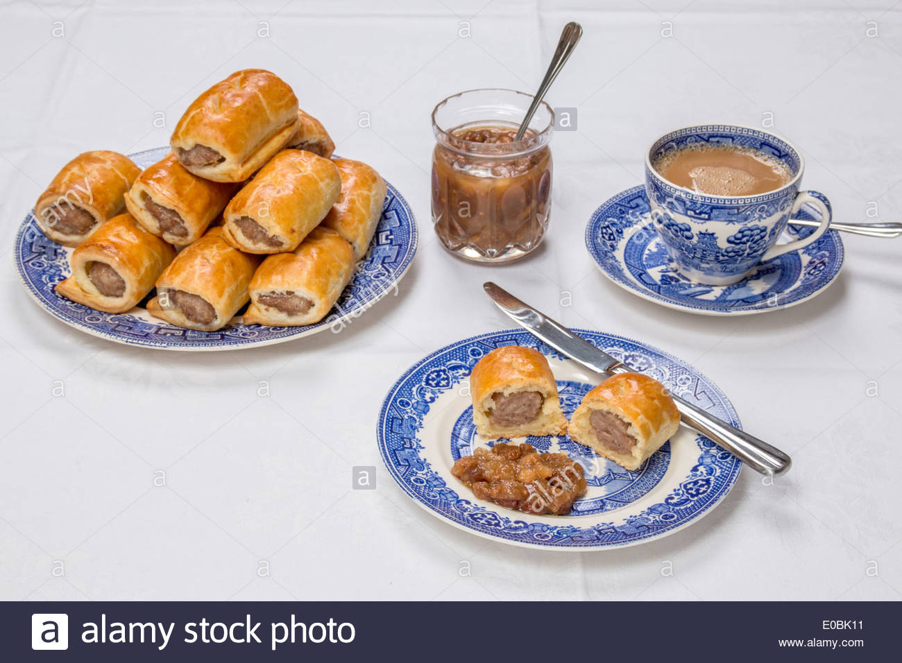 making-sausage-rolls-using-ready-rolled-pastry-cut-sausage-roll-on-E0BK11%5B1%5D